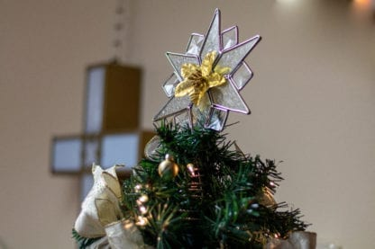 Star On Gold Ribbon Covered Christmas Tree